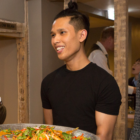 Waiter with large tray of food at the Giggling Squid Farnham Launch Rebecca Fennell Photography